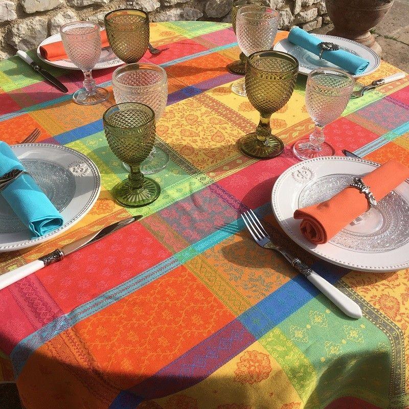 "Round coated Jacquard tablecloth ""Maussane"" Orange and turquoise"