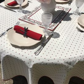 """Coated cotton round tablecloth """"Calisson"""" ecru and red by Tissus Toselli"""