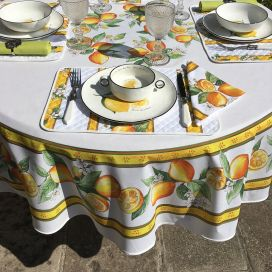 """Round coated cotton tablecloth """"Lemons"""" ecru and yellow from Tissus Toselli"""