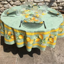 "Round coated cotton tablecloth ""Lemons"" yellow and green, by TISSUS TOSELLI"