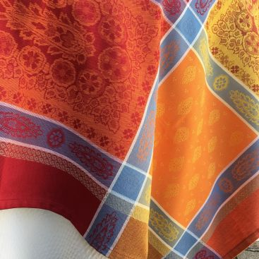 """Webbed Jacquard tablecloth """"Vaucluse"""" red and orange, by TISSUS TOSELLI, Nice"""