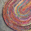 Colored oval jute and cotton rug
