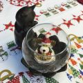 Black cat on a bowl candle holder